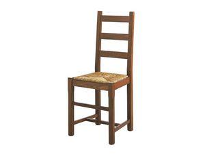 334, Fauteuil en bois massif, avec assise en paille