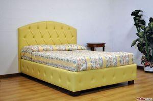 Rondeau, Lit rembourré classique avec tête de lit capitonnée courbée