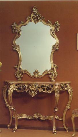 565 MIROIR, Miroir avec cadre sculpté, avec la finition à la feuille d'or