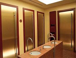 Fortuny, Porte en laiton brossé, poignées en acier inoxydable, pour les bains d'hôtels et les bars