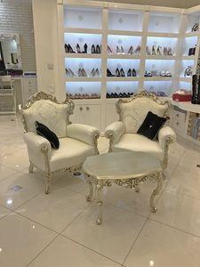 Stradivari, Table basse, bois sculpt�, dessus en marbre
