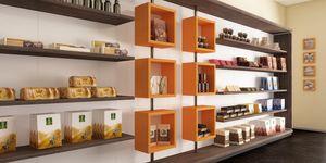 Révolution - étagères pour les boulangeries et les cafés, Mur d'exposition avec des cubes rotatifs